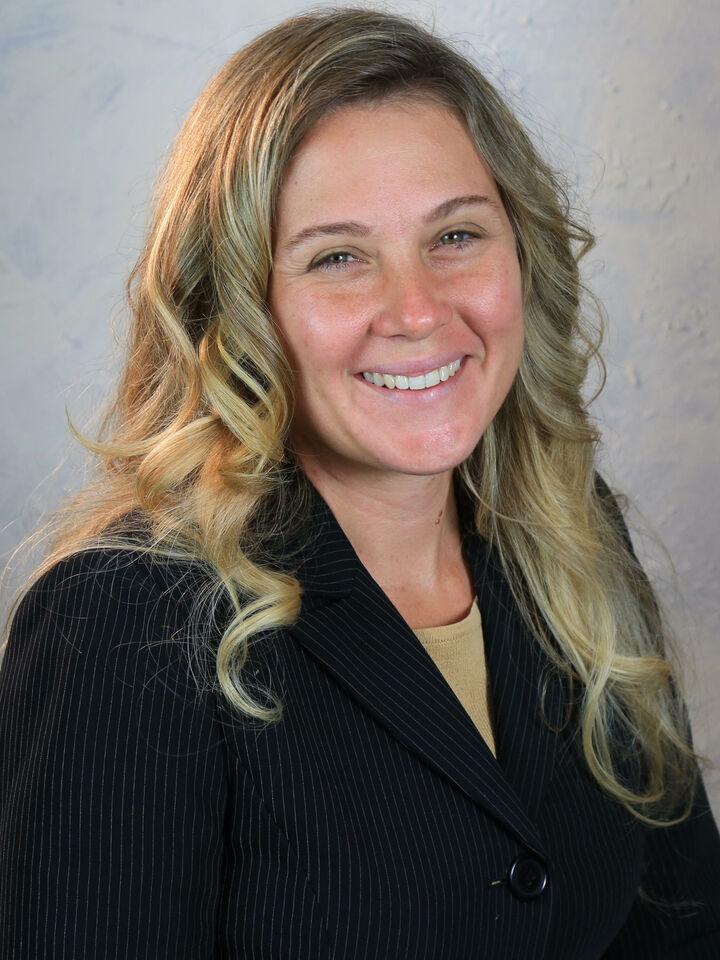 Karen Leonardo,  in Hernando Beach, Dennis Realty & Investment Corp.